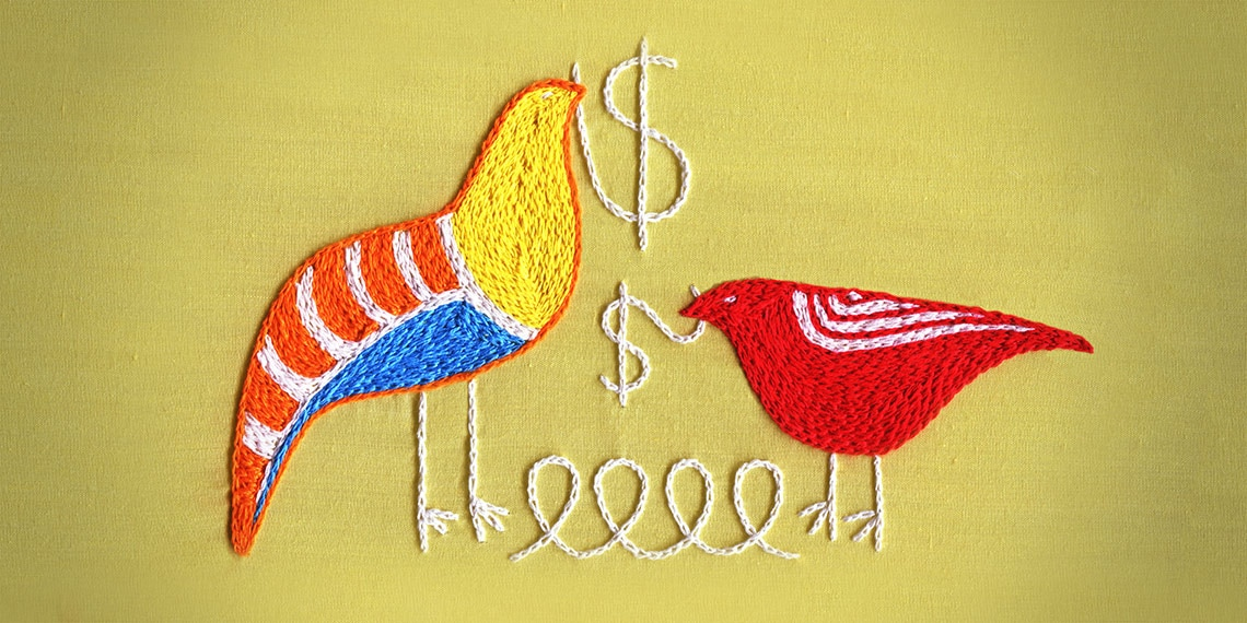 A needlepoint of two birds with a yarn in their beaks.
